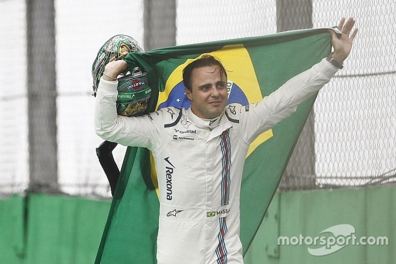 f1-brazilian-gp-2016-felipe-massa-williams-carries-a-brazilian-flag-as-he-walks-back-to-hi